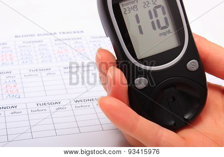 Hand Of Woman With Glucometer And Medical Form