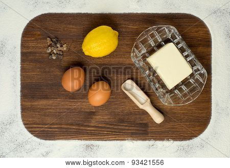 Baking ingredients - flour, eggs and rolling pin on table