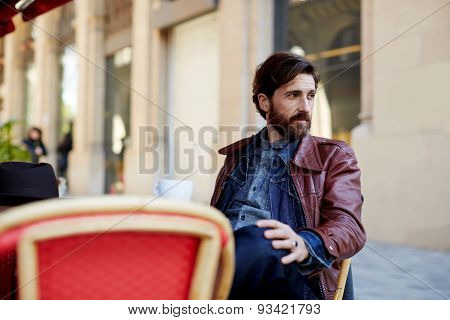 Portrait of  adult fashionable hipster having coffee in beautiful cafe terrace