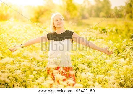 Portrait Of Gorgeous Young Woman In Sunlight Outside