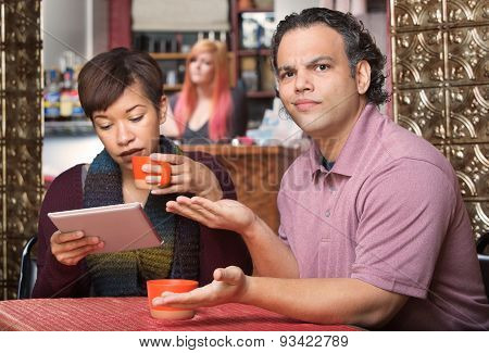 Spouse Reading Tablet And Annoying Husband