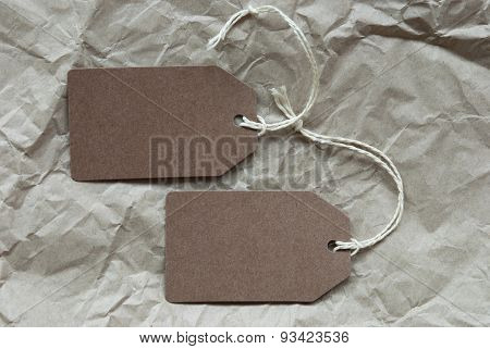 Two Brown Labels With Copy Space Paper Background