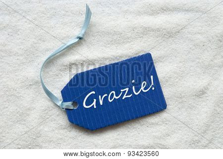 Grazie Means Thank You Blue Label Sand Background