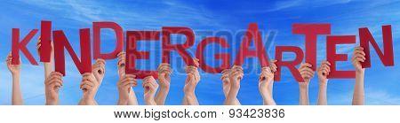 Hands Holding Red Word Kindergarten Blue Sky
