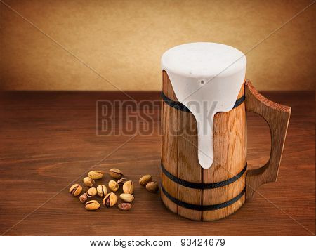 Wooden Mug On Wooden Background.