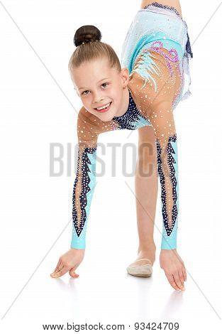 Beautiful girl gymnast doing exercises closeup