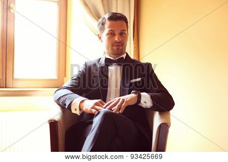 Elegant Young Fashion Man In A Hotel Room