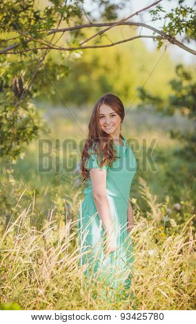 Candid skipping carefree adorable woman in field