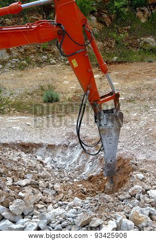 Large hydraulic Jackhammer Smashing Rocks