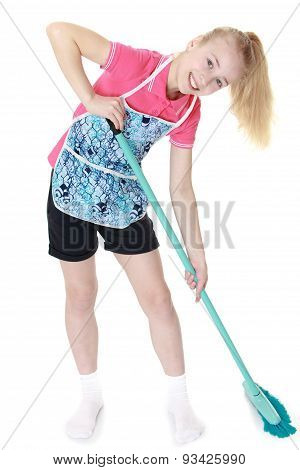 Beautiful blonde girl in apron sweeping floor brush
