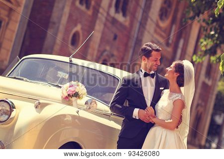 Bride And Groom With A Retro Car