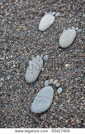 Footprint On Wet Sea Pebbles