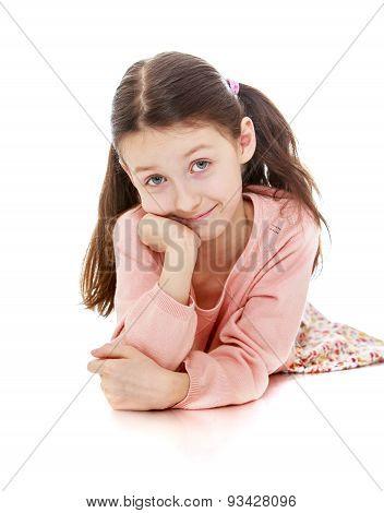 Charming girl schoolgirl lies on the floor