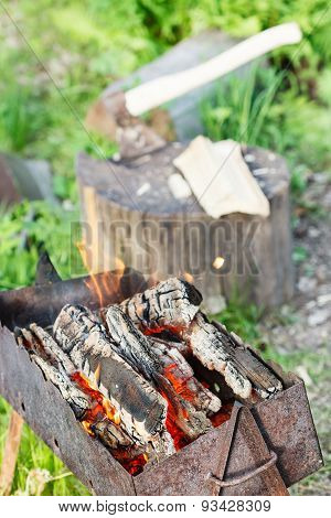 Firewood Burning In Outdoor Brazier
