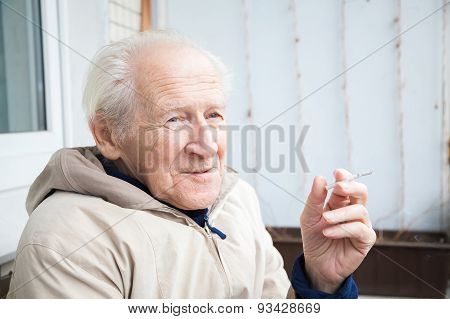 Smiling Old Man With A Cigarette