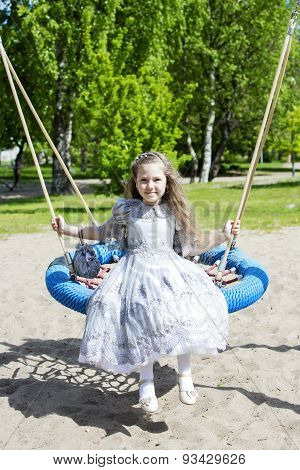 Dressed Like Princess Girl On A Swing