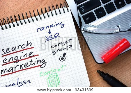 Notepad with words search engine marketing.