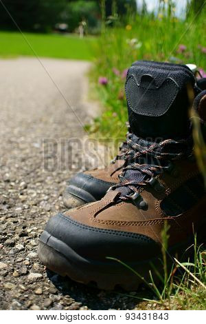 Close-up Of Hiking Boots On The Roadside