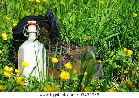 Hiking Boots On A Summer Meadow