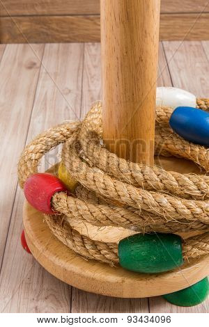 Ring Toss Game On Wood Background