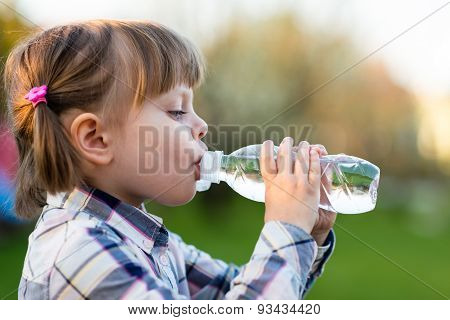 Portrait Of Little Girl Drinking Water Outdoor