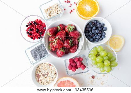 healthy eating, dieting, vegetarian food and people concept - close up of fruits and berries in bowl on table