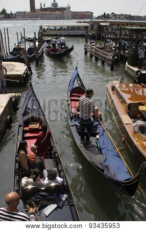 Gondola on the canal in Venice, Italy on a bright sunny day