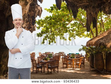 cooking, profession, inspiration and people concept - happy male chef cook thinking over restaurant lounge on beach