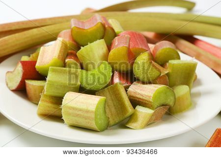 detail of chopped rhubarb on white plate