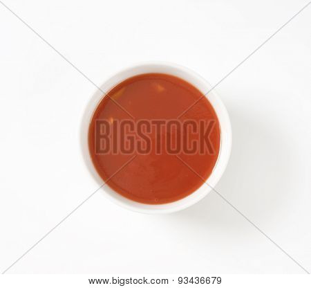 bowl of tomato soup on white background