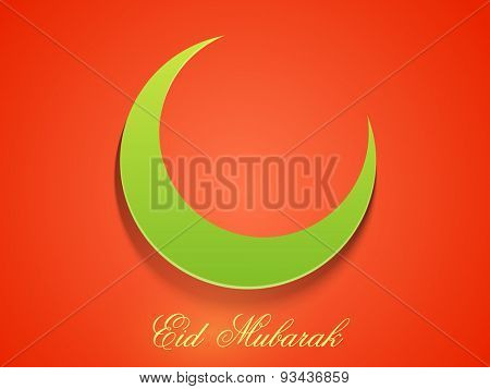 Green glossy paper cutout of a crescent moon on orange background for muslim community festival, Eid Mubarak celebration.