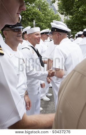 NEW YORK - MAY 22 2015: US Navy sailors line up to be congratulated after the promotion ceremony at the National September 11 Memorial site during Fleet Week 2015.
