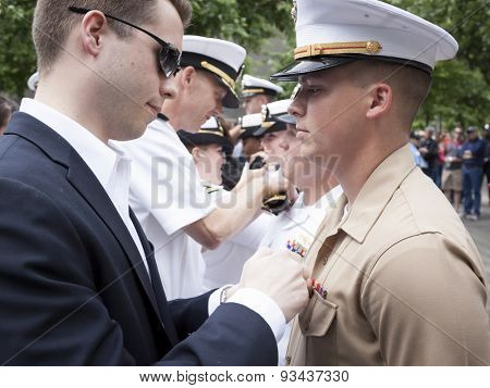 NEW YORK - MAY 22 2015: A US Marine receives his promotion insignia during the ceremony held at the National September 11 Memorial site during Fleet Week 2015.