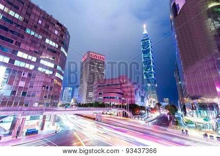 Busy traffic light trails in modern street