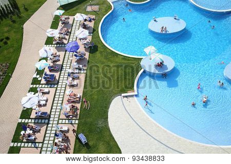 SOCHI, RUSSIA - JUL 26, 2014: Big swimming pool with tourists on site Hotel Radisson Blu Paradise Resort and Spa