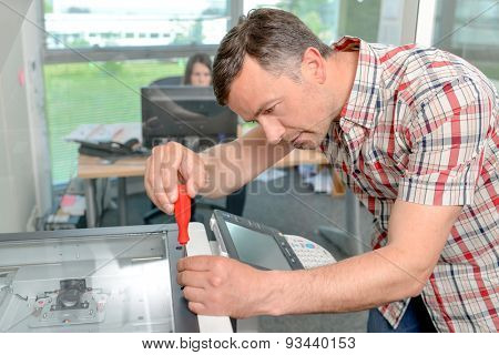 Handyman fixing the office printer