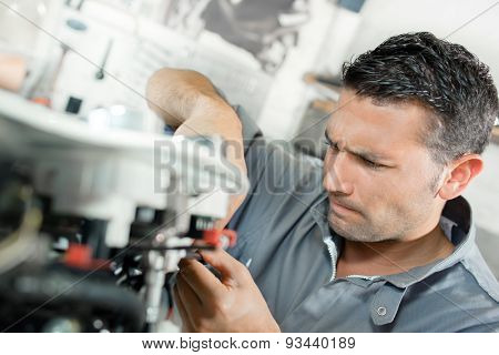 Man using machinery