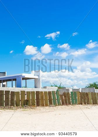 Seaside Building On The Beach With Blue Sky