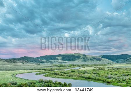 dusk over North Platte River in Colorado North park above Northgate Canyon, early summer scenery with waterfowl