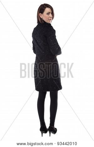 Image of young woman in fur karakul coat