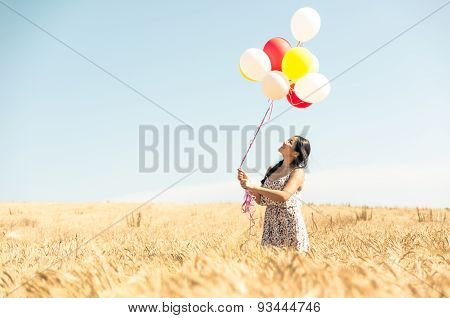 Beautiful Asian Woman In A Wheat Field With Air Balloons