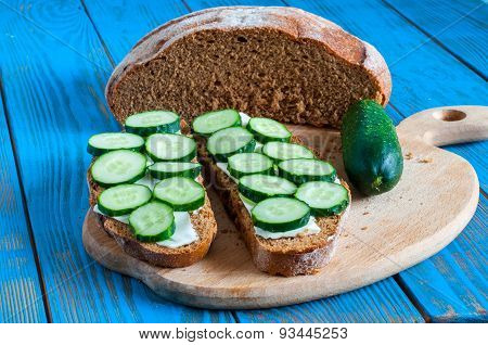 Freshly Baked Bread, Cucumber And Sandwich With Sliced Cucumbers In Rural Or Rustic Kitchen On Vinta