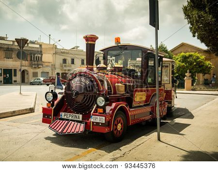 MEDINA, MALTA - MAY 26: Excursion train in the historical part of the city. Medina, Malta on May, 26  2015. Medina - this is the first capital of Malta