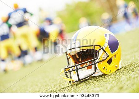American football helmet lying on field