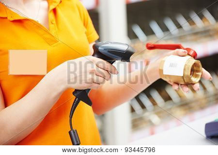 female hands with bar code scanner scanning hardware plumber good at store