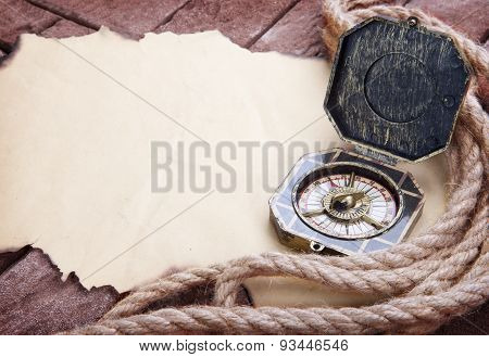 Vintage Compass On The Paper And Marine Ropes