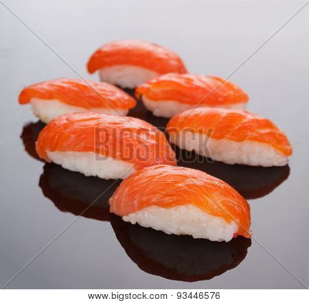 Sushi With Red Salmon On A Black Background