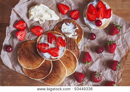 Pancakes homemade sweet dessert for breakfast or lunch with strawberry and butter on rustic wooden k