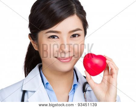 Asian female doctor hold with heart ball