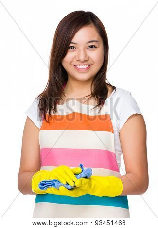 Young housewife with plastic glove and rag